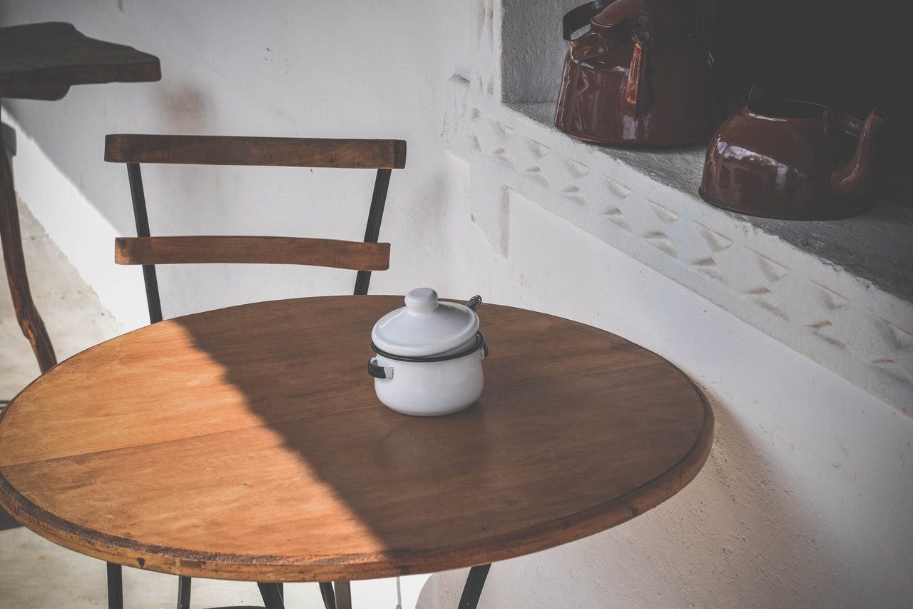 round brown wooden table and chair 1826387 - 【木製ダイニングテーブル6選】高級メーカー紹介&材質の種類も解説!